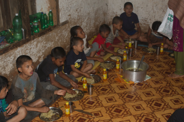 Last night party - Kids eating goat and beaten rice